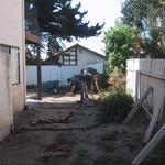"Entry side yard needs new fencing as well as a ""defined"" area for utility use that separates it from the rear ""ornamental"" yard."