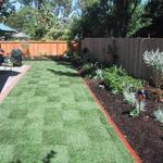 "in keeping with thata same theme, new funcing and mow strip definitions make the yard ""flow"" from one area to the next."